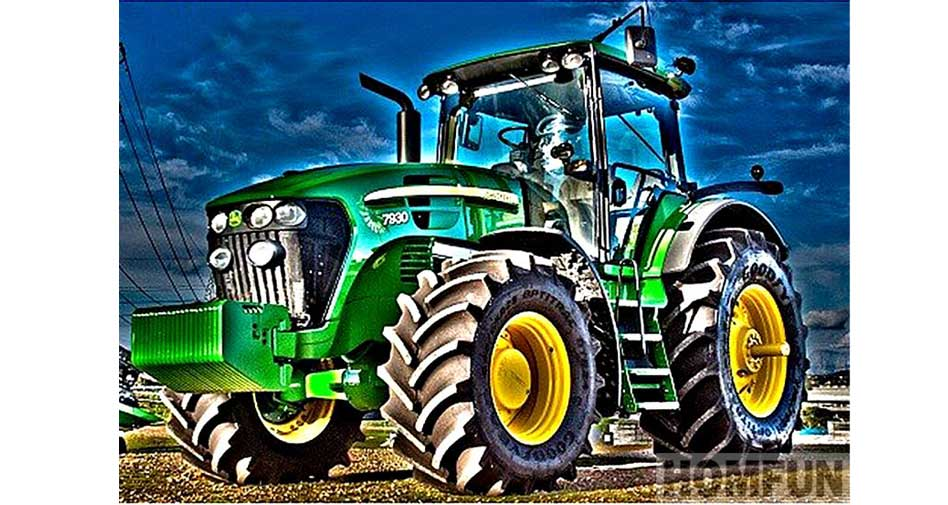 A green tractor in a field.